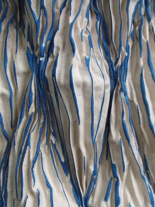 This particular photo demonstrates the fabric manipulation techniques of pleating, pinning, tucking and dipping. The fabric has then been dyed.