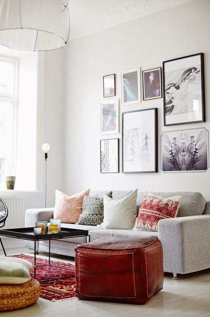 This is a nice-looking living room with smaller rug. Perhaps the key is to frame the rug with sofas / sofa and armchair combo / sofa and the window. And another trick is to fill up the room so the size doesn't look awkward.