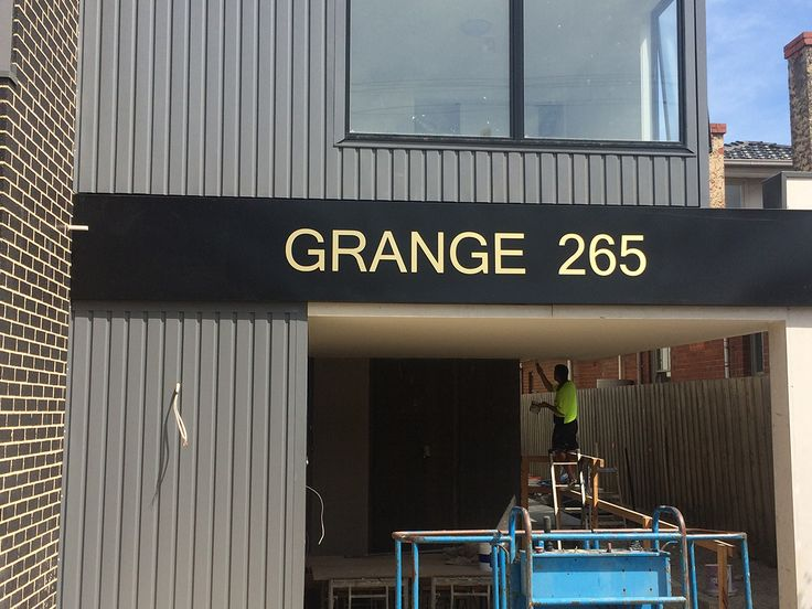 3mm Brushed Metallic comp panel formecut to shape and mounted to fascia.  Installed on new house developments. #Sign #Signs #Signage #3mm #CompPanel #Gold #NewDevelopments #Housing #HouseSignage #Fascia #Formecut