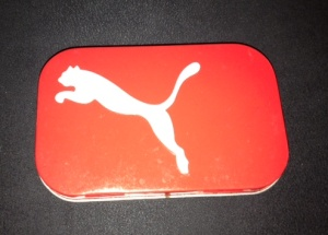 Puma tin doubles as a coin purse