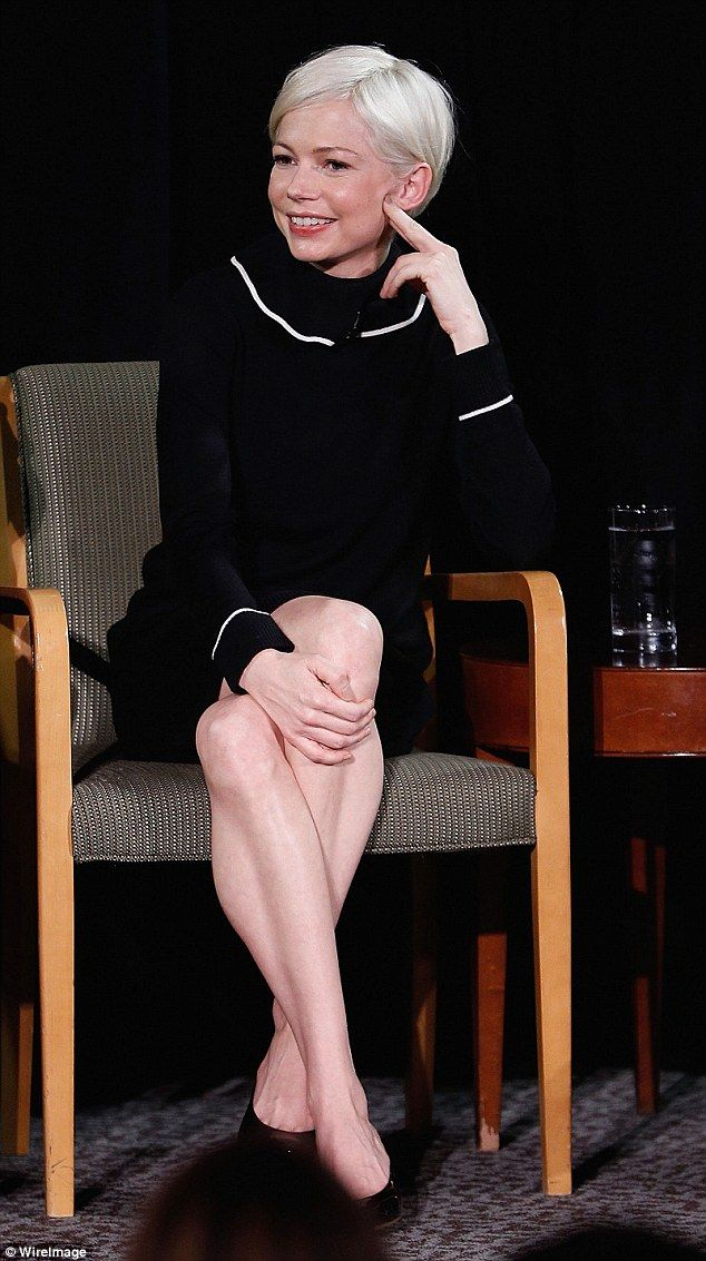 Natural beauty: Michelle Williams, 36,wore a long-sleeved black dress with white piping a...