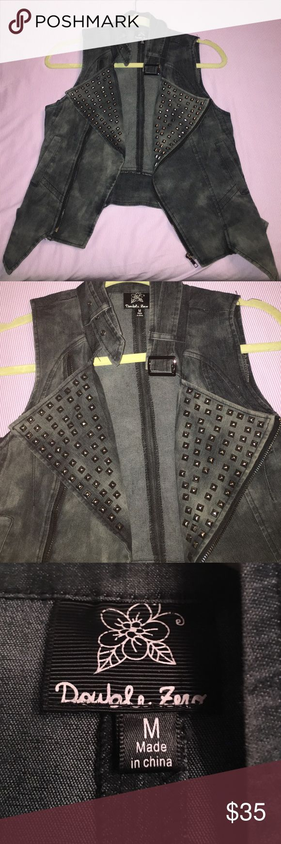 Women's charcoal gray vest In excellent condition worn once. Gray semi tie dye women's jean vest. Folds over by the breast area with patches of studs. Belt around the neck. Very cool and trendy. Has a zipper. 2 pockets on the sides too Double Zero Jackets & Coats Vests