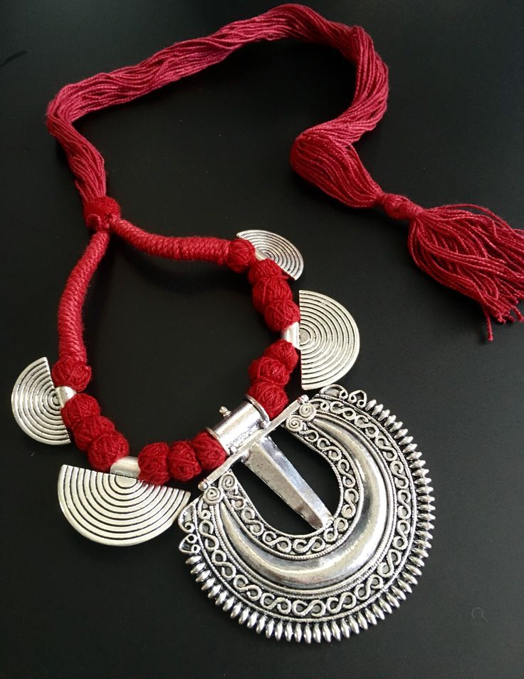 unique oxidized necklace in ethnic eco friendly red thread. this neckpiece does not come with earrings.