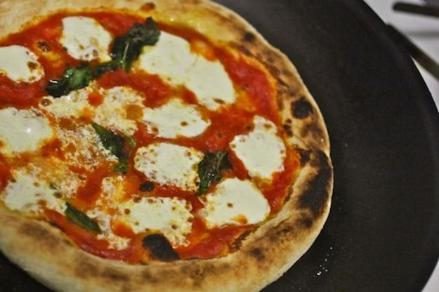 This recipe is about as close as you can get to wood-burning oven-style Neapolitan pizza without having to void the warranty of your oven. The Antimo Caputo Tipo \