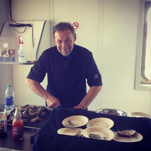Our chef shucks fresh PEI oysters on board as part of our Seaside Experiences.    Photo by @jenniferhennick3