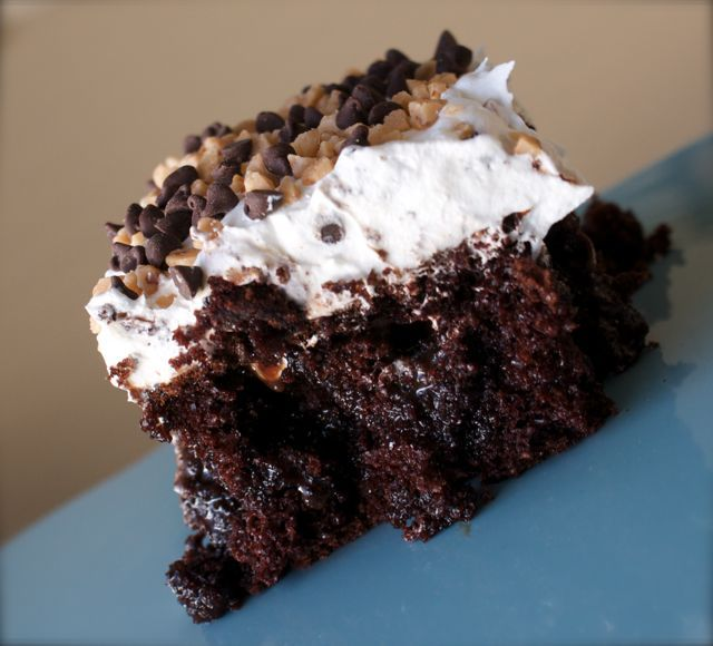 Chocolate Caramel & Cool Whip Cake - not a fan of whipped cream frosting, but this looks pretty good anyway