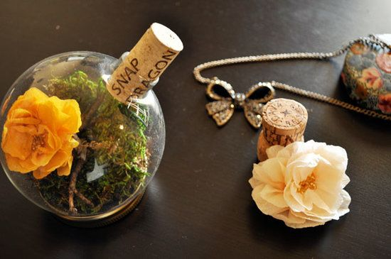 Terrarium Place Card Holders: For something truly special, delight guests with terrarium place card holders that they can continue to enjoy once the wedding is over.  Photo by Garett and Jessica Mayfield via Green Wedding Shoes