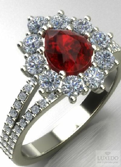 A Stunning Drop cut Burmese Ruby is the star of this precious ring. A modern classic from Luxedogems.com