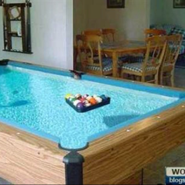 32 things you need in your man cave the future caves for Koi pond pool table