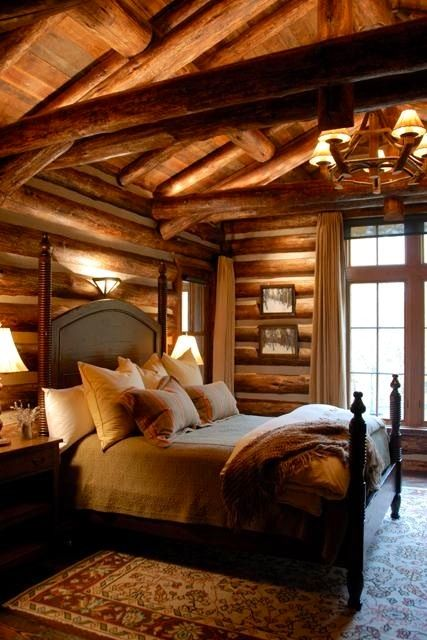 Beautiful Log Home Bedroom - wow, never would have thought of oriental rug with log bed