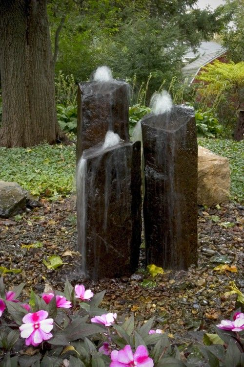These standing stones have been drilled up the middle to create fountains.  The pump is hidden in the sump beneath.