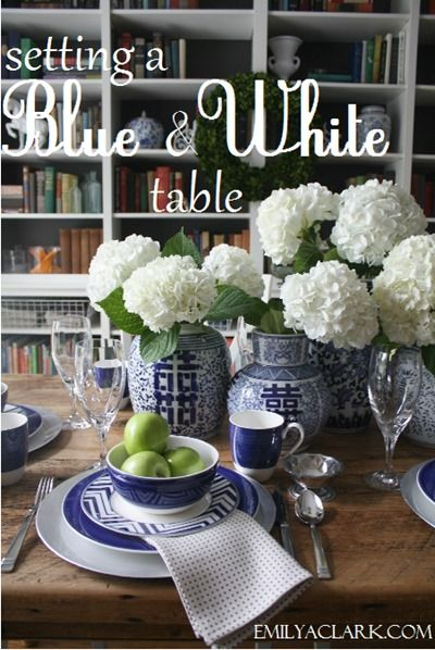 blue and white table setting with white hydrangeas