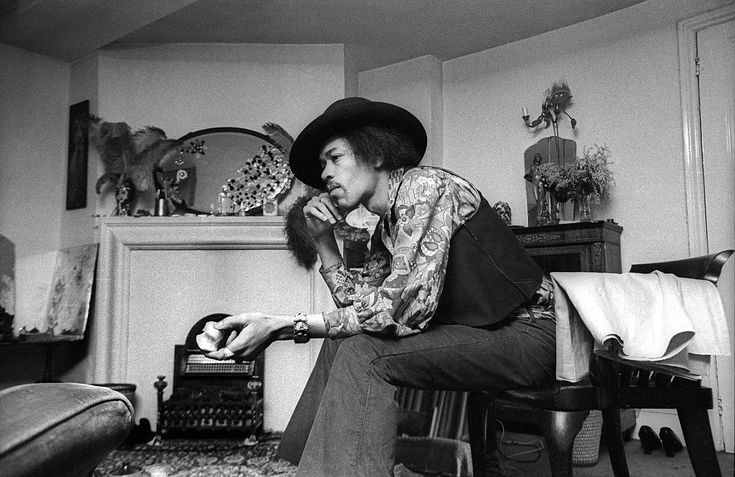 Hendrix in his trademark hat sitting in the London flat in 1969, which now looks exactly as it did when he lived there