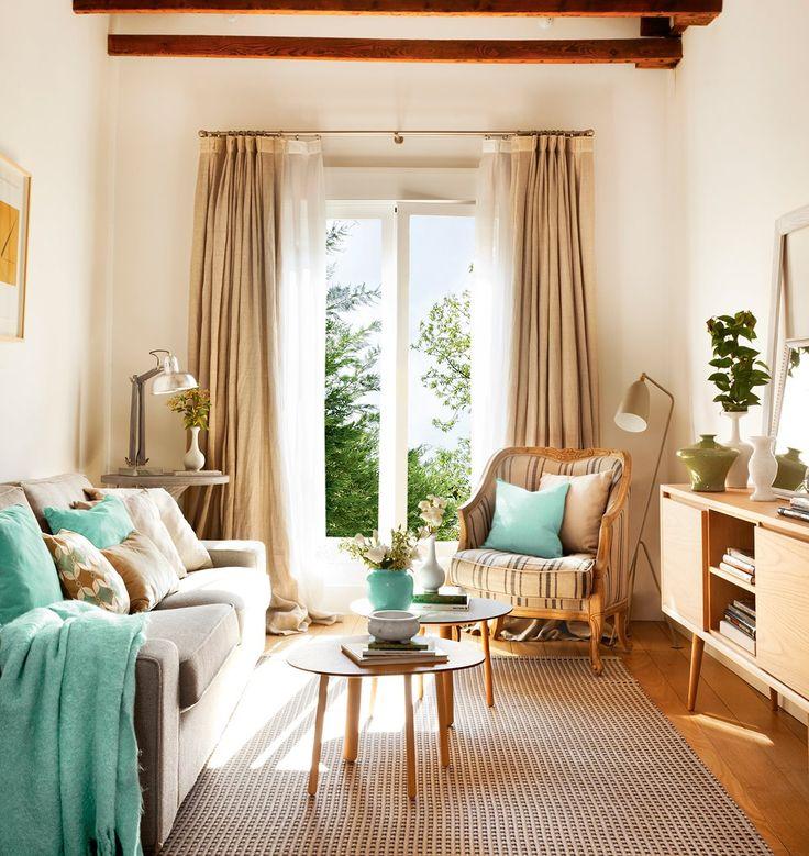 La zona de estar*. Un ático pequeño y muy cómodo · ElMueble.com · Casas