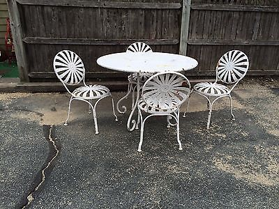 Francois-Carre-set-of-4-spring-steel-chairs-and-iron-table BIN $2200