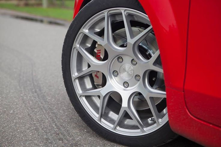 Big brake kit and custom nickel calipers finish off the sleek look