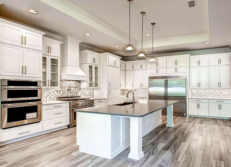Gorgeous White And Grey Kitchen In Orlando, Florida By D.R. Horton   Love  The Grey Wood Style Tiles Throughout The Kitchen!