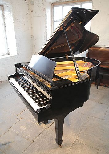 A 1973, Yamaha C3 grand piano for sale with a black case and spade legs at Besbrode Pianos £4500