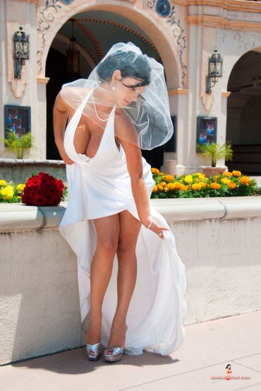 Nobody models bridal gown fashions better than Denise Milani.