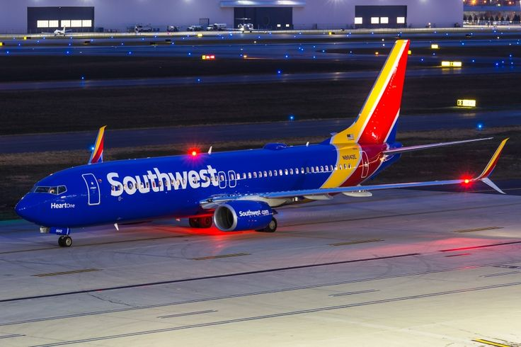 """Love the colors in this shot! A picture of """"Heart One"""" the first plane in the new Southwest Airlines livery. Boeing 737-800. The aircraft registration is N8642E"""
