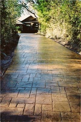 stamped concrete driveway - this website has a ton of good options #stamped concrete driveway ideas
