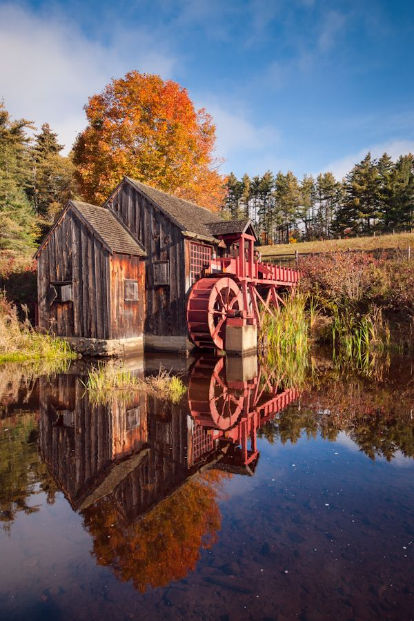 The grist mill in Guildhall, Vermont, is one of the most scenic old grist mills in New England. On a calm morning, the mill and foliage casts a mirror reflection in the adjoining pond. This image was made early morning at the peak of fall foliage.