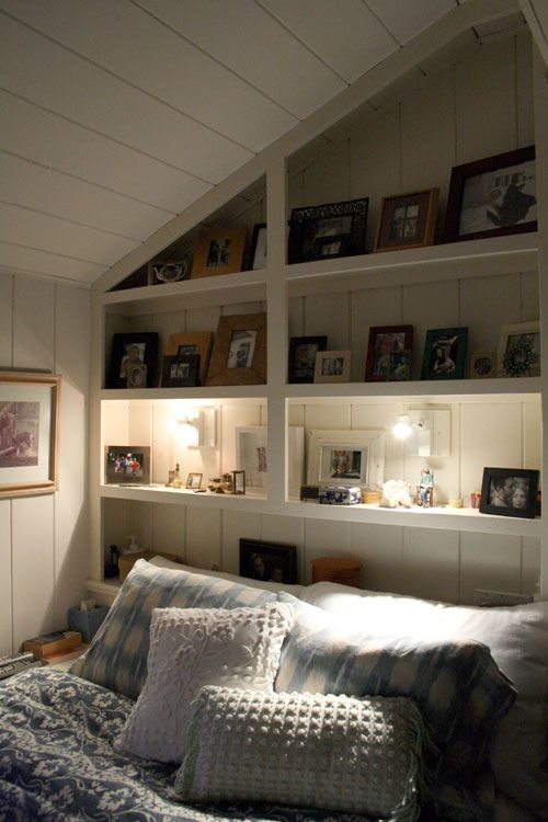 White wood boards on the walls and ceiling, built-in shelves on either end,