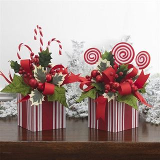 my satin boxes could be made into christmas floral arrangements.  using peppermint candy and candy canes, to match my candy tree!