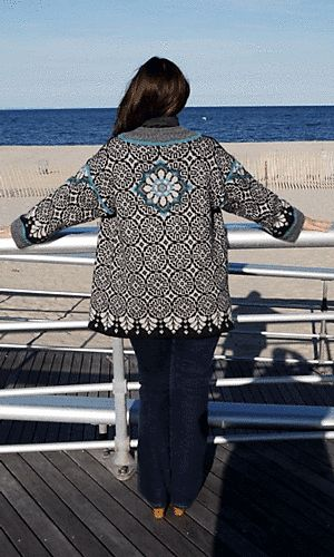 A kimono-inspired jacket worked in Fair Isle-style stranded colorwork with duplicate stitch accents and wide contrasting borders.