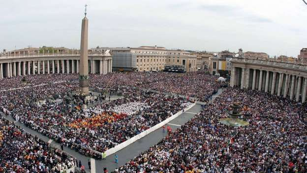 """Tiny enclave  Just 0.44 square kilometers, including the Vatican City, in the heart of the """"Eternal City"""" of Rome. The enclave around St. Peter's and St. Peter's Square is the center of the Catholic world. The Pope, the clergy and members of the Swiss Guard bringing it to a total of approximately 900 residents ,"""