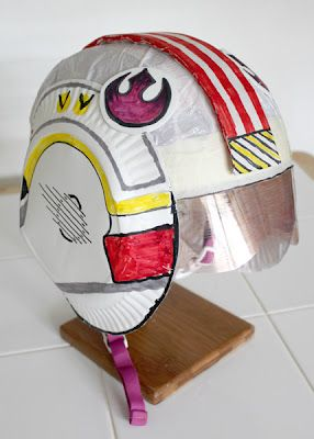 X-Wing Fighter Helmet made using a Bicycle helmet.  Goes with the cute X-Wing Iron on t-shirt costumes Filth Wizardry made.  For anyone with kids that are Star Wars fans she has some excellent tutorials on some great Star Wars stuff!