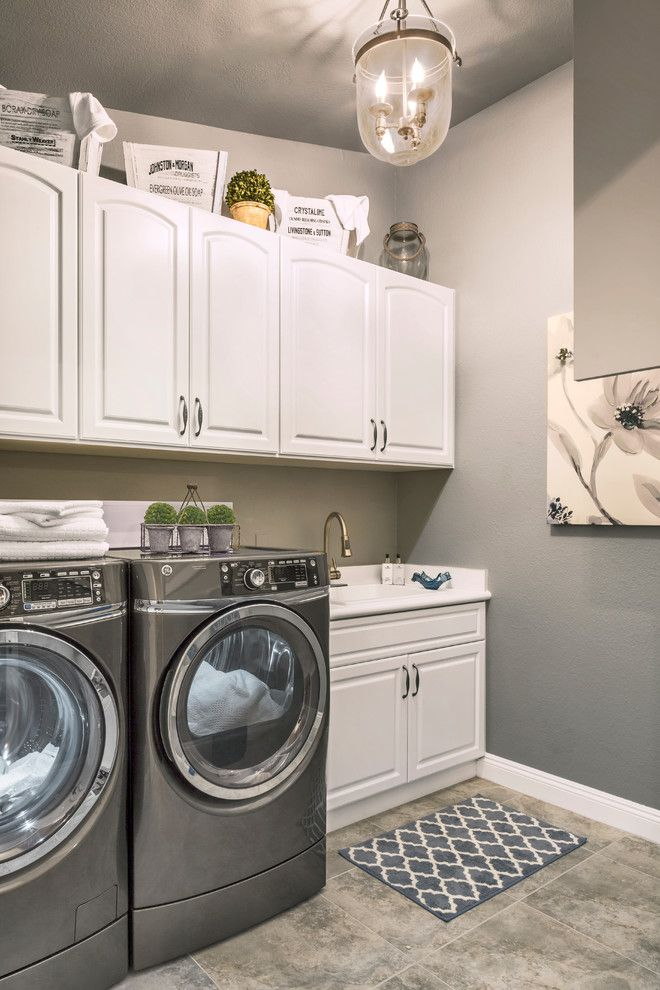 Simple Laundry Room With White Cabinets Grey Washer Dryer And Rustic Lighting