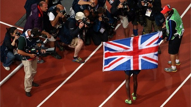 Mohamed Farah of Great Britain celebrates winning gold in the men's 10,000m Final on Day 8 of the London 2012 Olympic Games at Olympic Stadium.