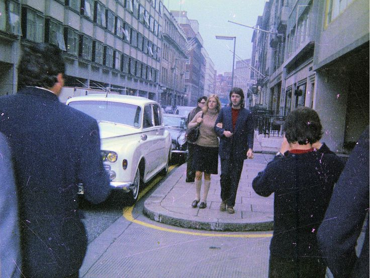 Paul and Linda McCartney outside Apple Corps in 1969