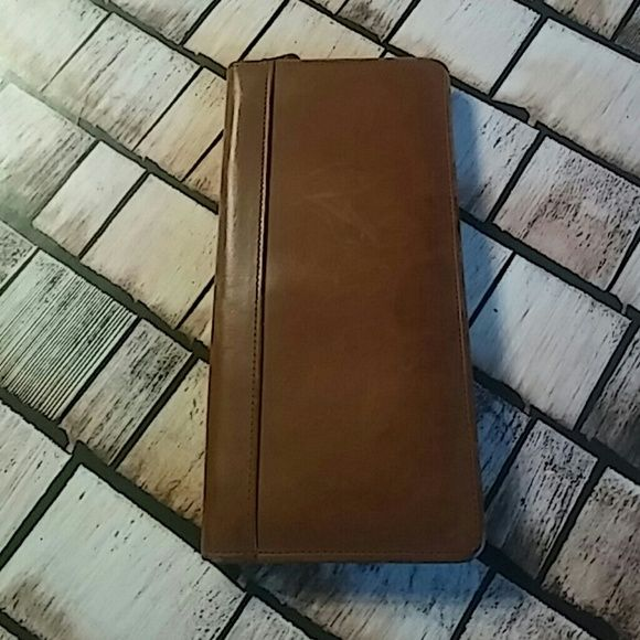 Coach Ticket Holder Perfect wallet for all your traveling needs. Brown leather has some scratches. Zip around closure. Slots for plane tickets, credit cards and clear Id window. Small zip pocket on back for change. 4.5x9 Coach Bags Wallets