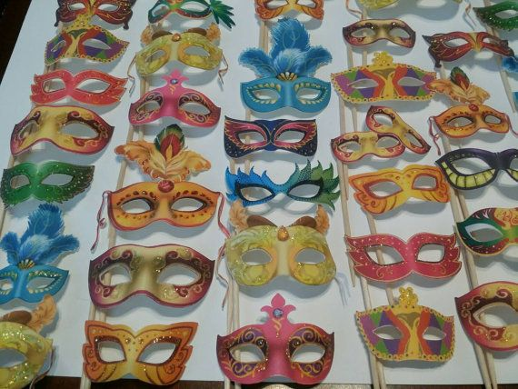 Individually Hand Glittered Masquerade Cupcake Toppers / by Akatei