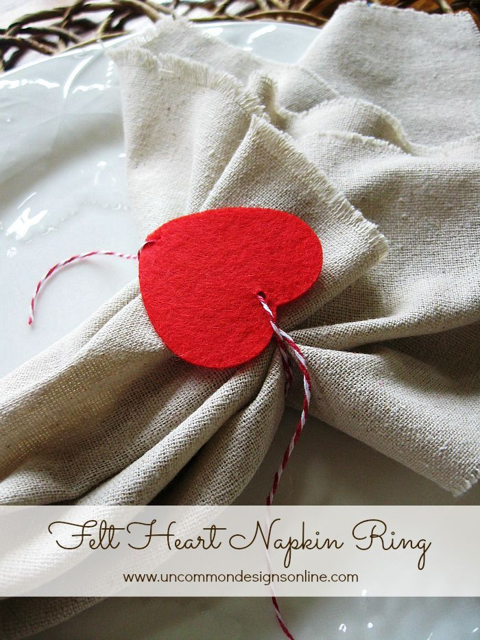 Create these adorable felt heart Valentine napkin rings with this tutorial. Simple, quick, and easy for a casual and fun Valentine's Day table! via Uncommon Designs