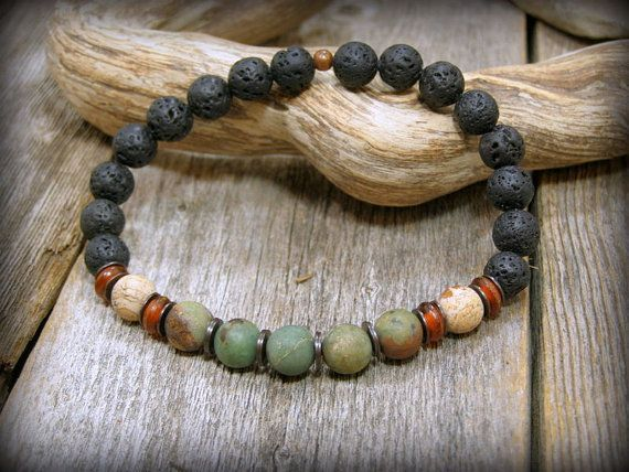 Earthy rustic and gorgeous, this mens bracelet is beaded with all natural stones of.... 8mm matte african green opal, dark amber horn rondelles, 8mm matte picture jasper and 8mm black smooth lava rock beads. The color combination is unique and bold....wear this one with jeans or dress it up with other cool bracelets for a stack look. Size: Choose from the drop down menu above right. ***** Please note....measure your wrist before ordering. See my policies for resizing fees. ***** Look for…