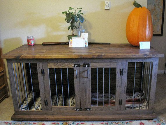 Beautifully crafted home for your pet! This double kennel/table serves as a dual functioning piece of furniture. This eliminates the need of moving a large crate around to save space! This unit is wrapped in steel round bar, which not only will last, but gives it a clean look. Finished with a beautiful stain color of your choosing & tough finish, this kennel will last for years to come and be the perfect conversation starter! Can be custom made to fit any space! ($150 custom size req...
