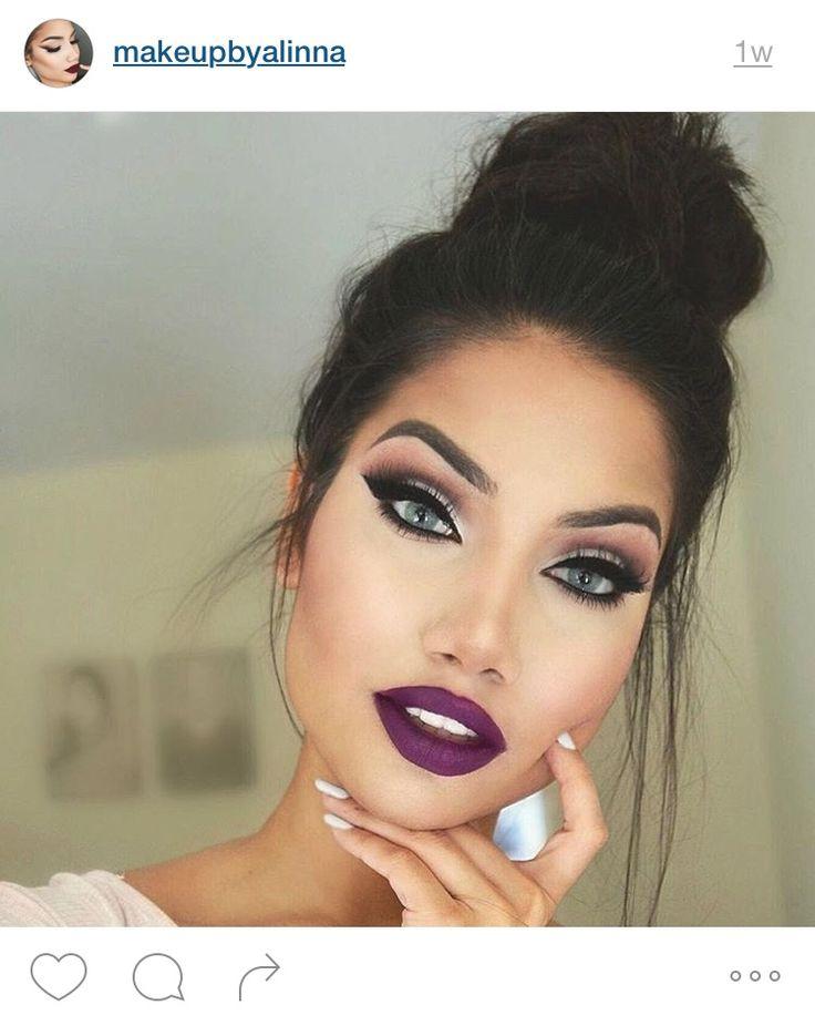Deep eyeliner and dark purple lips on this blue eyed beauty