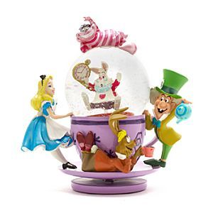 Disney Alice in Wonderland Tea Party Snow Globe | Disney StoreAlice in Wonderland Tea Party Snow Globe - Don't be too late for an Alice in Wonderland tea party snow globe that brings home the madcap charm of the classic film. The glass globe perches on a spinning tea cup, as familiar characters cling on around the outside!