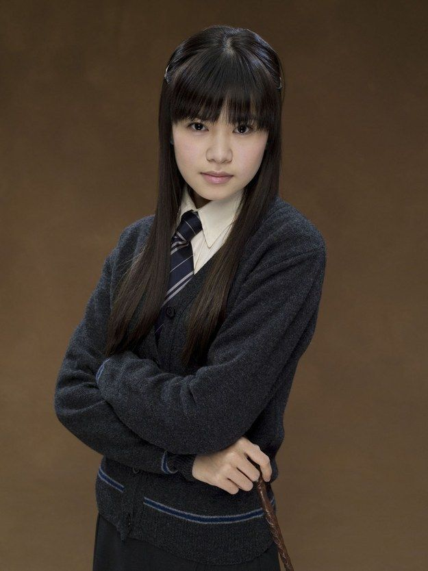 """The haircut, which Katie went on to describe as """"horrific,"""" was this brow-skimming bangs look. 