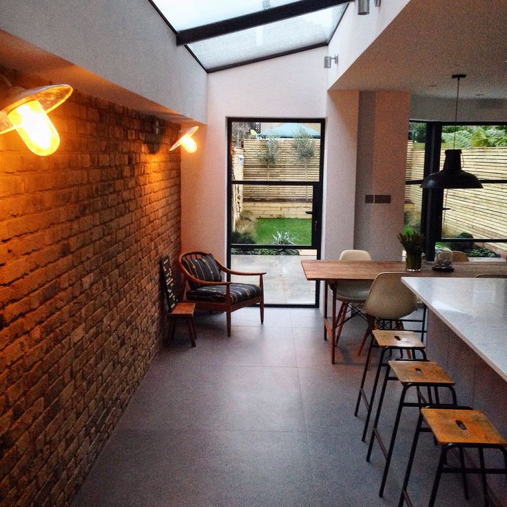 Industrial kitchen with side return, large ceiling glass, crittal windows & doors and concrete tiles.