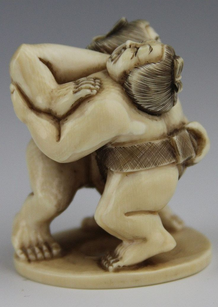 """Description: CARVED JAPANESE IVORY OKIMONO SUMO WRESTLERS Japanese carved ivory okimono of two Sumo wrestlers, signature to bottom. Weight: 37g Size: 2 x 1.5 x 1.25"""""""