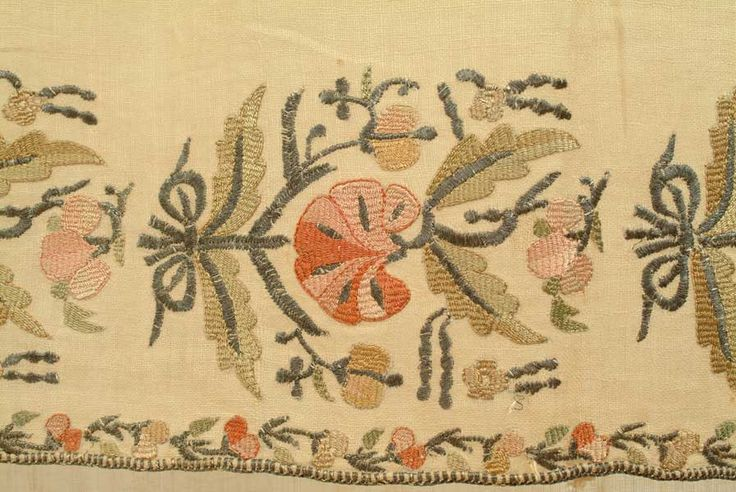 With two borders of four fan-shaped flowers worked in silk and metal embroidery.