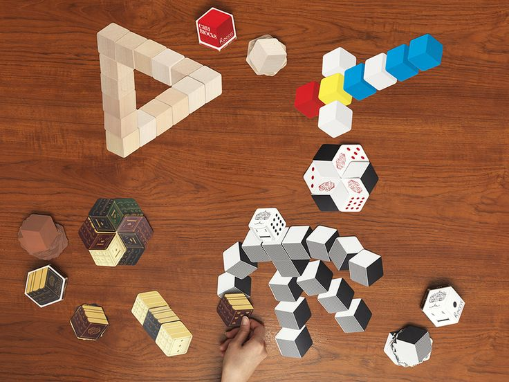 A hexagonal card game created by a game designer and a graphic designer. Inspired by a meeting with legendary designer of board games Alex Randolph, Rocca takes it's name from rokkaku – hexagon in Japanese – and moves between the genres of 2D and 3D games.