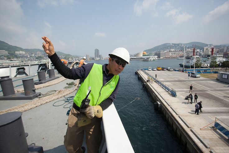 Jay de Guzman (Canada) gives a sign to deck hands at the mooring station.