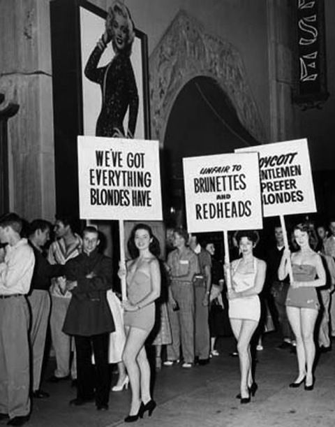 """Non-blondes picket outside of the ChineseTheaterin 1953 at thepremiereof """"Gentlemen Prefer Blondes."""""""