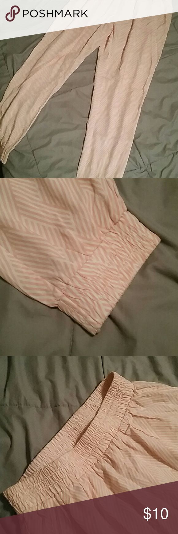 Peach Jumper Pants Stripped pattern, peach color.  These pants are tight around the waist and ankles but loose fitting on the thighs, butt, and legs. Very thin material and very comfortable. In great condition. I'm open to offers! Pants Jumpsuits & Rompers