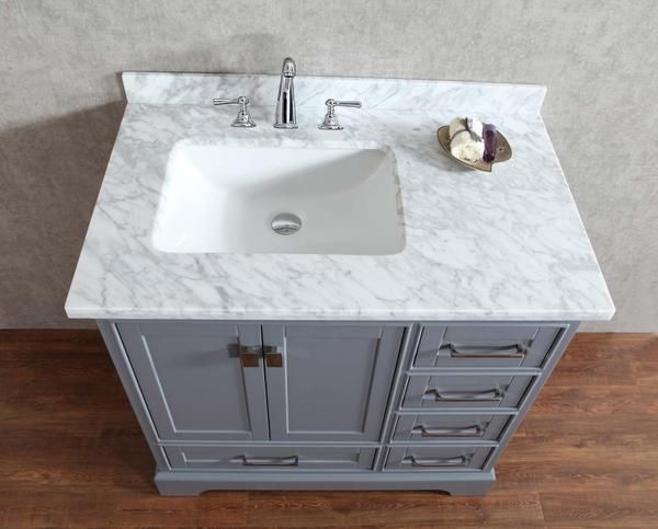 Amp up any bathroom's decor with a vanity as tasteful as the Newport Grey 36-inch Single Sink. The complete vanity includes a cabinet, a mirror and a basin. Thi